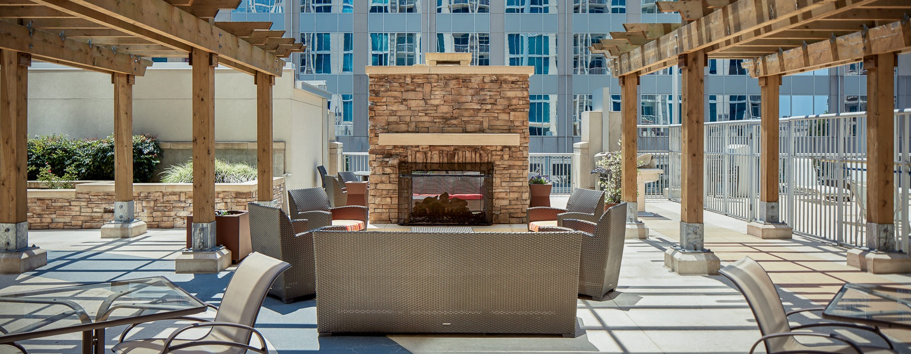 outdoor fire place with seating under pergola