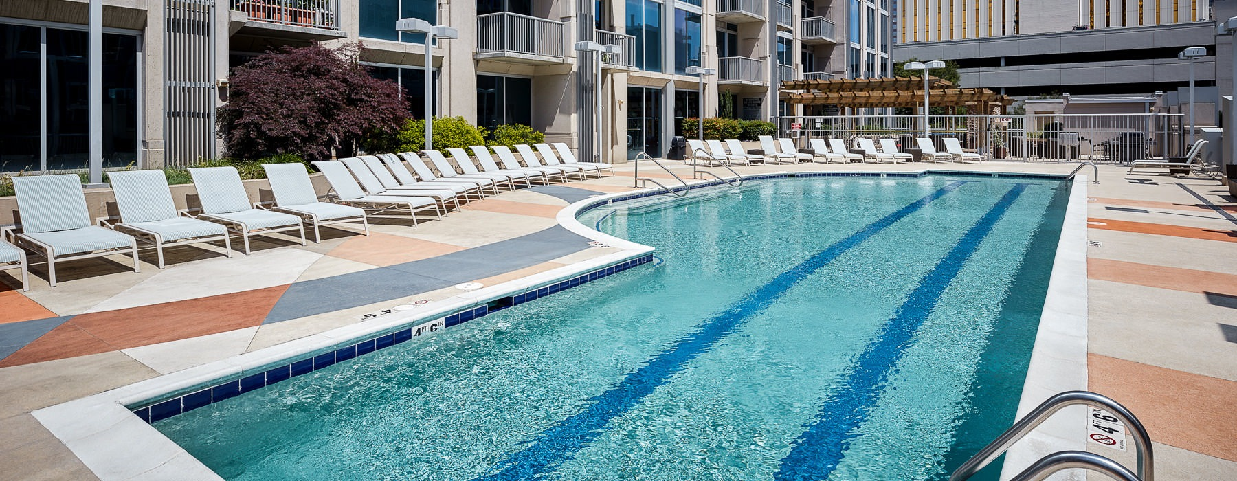 outdoor swimming pool surrounded by lounge chairs